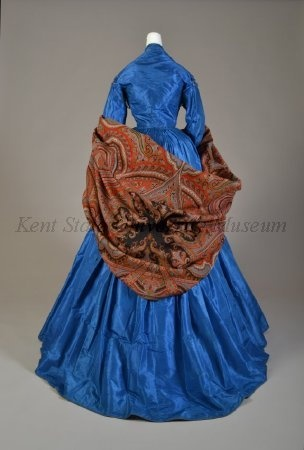 Blue taffeta afternoon dress with cashmere shawl, American, 1860s. Collection of the Kent State University Museum, 1995.17.52ab  (dress) and 1983.1.1545 (shawl) Photograph by Joanne Arnett, 2012.