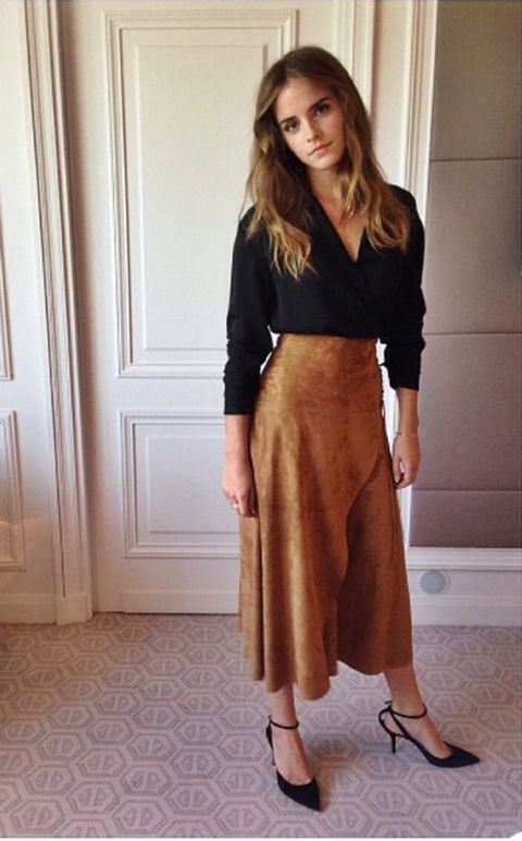 Suede skirt perfection from Emma Watson | Image via elle.com