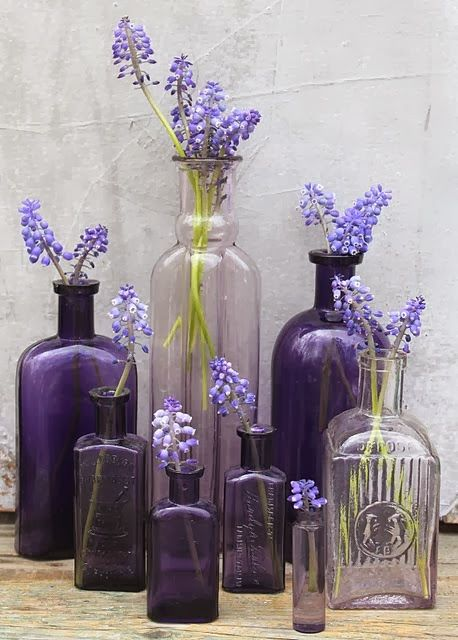 different shades of green and purple glass... filled with greens, babys breathe and lavender ?