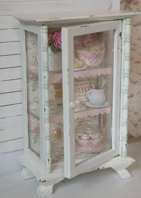 "Shabby Chic cabinet done in ""chippy white"" style.  I like the wallpaper backboard."