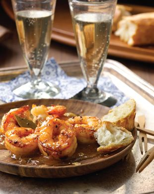 New Orleans BBQ Shrimp> so simple to make. Butter, beer, cayenne, a little hot sauce, black pepper and worcheshire sauce, all in a roasting pan with huge raw shrimp. Bake til pink and serve with french bread and YES, champagne sounds good!  Don't even be tempted to use anything BUT real butter, salted kind.