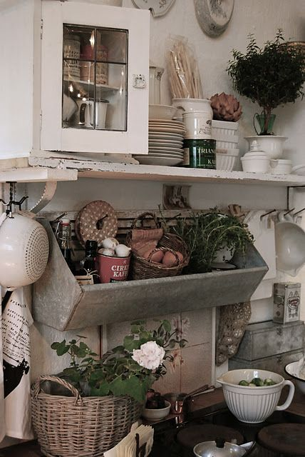 So much great going on in this kitchen, hanging galvanized box, leaded door, chippy shelves and brackets...