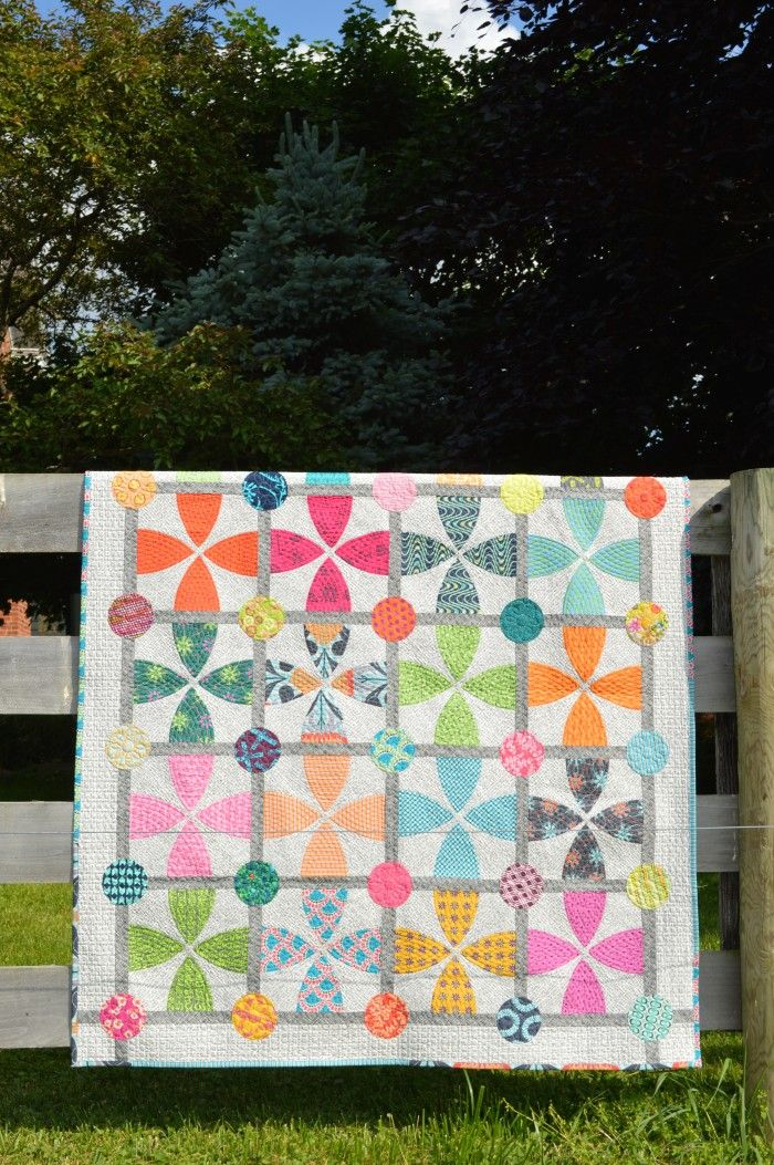 Whimsy Garden quilt, pattern by color girl quilts. Modern curved piecing with colorful fabrics