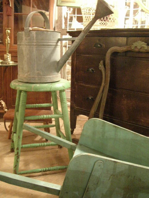 Sweet green stool, the wheelbarrow is not bad either - brimfield finds- first show starts May 13th make sure you visit Central Park