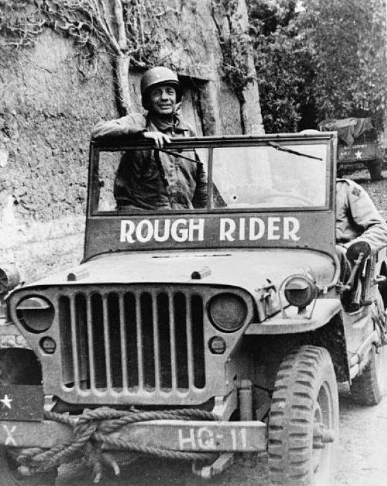 """Brigadier General Theodore Roosevelt Jr. in his Jeep """"Rough Rider"""" near the front lines in Normandy June 1944."""