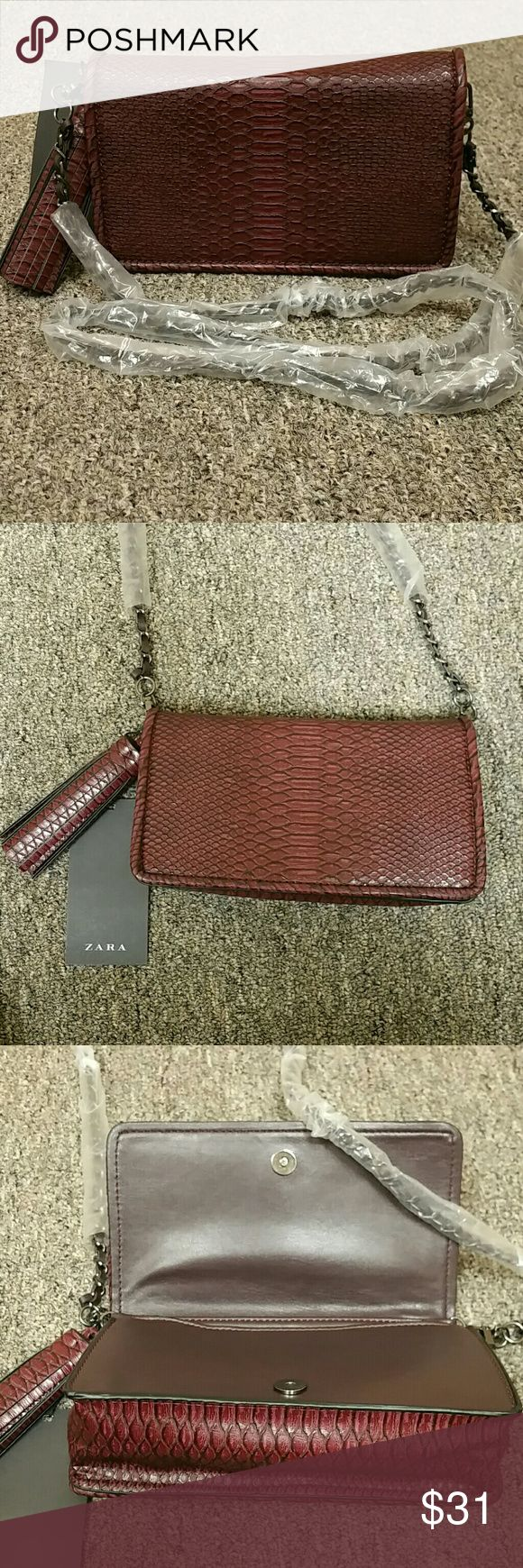 "NWT Zara faux snakeskin Crossbody/Clutch NWT Zara wine colored crossbody faux snakeskin  Approx.  4"" tassel - bag - 8"" X 4.5"" / 3 3/4"" depth  Chain drops 20""  Inside has Zippered front and side pocket,  snap closure / removable chain allows to be used as a Clutch /leather is weaved through chain Zara Bags Crossbody Bags"