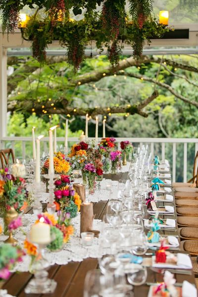 Very colorful table: http://www.stylemepretty.com/australia-weddings/queensland-au/2015/05/14/colorful-bohemian-wedding-at-the-sunshine-coast-queensland/ | Photography: Calli B - http://www.callibphotography.com.au/