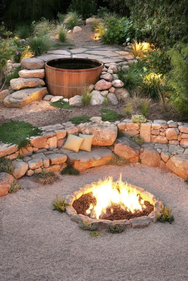 Just because you like it to look natural, doesn't mean you can't have a few indulgences such as a fire pit, hot tub and seating under the stars.
