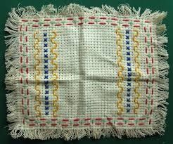 Primary School needlework. Sewing classes for girls - these pieces of material were used to teach basic and some fancy embroidery stitching. We proudly took them home and presented them to our parents and grand-parents who would display them on sideboards and dressing tables.