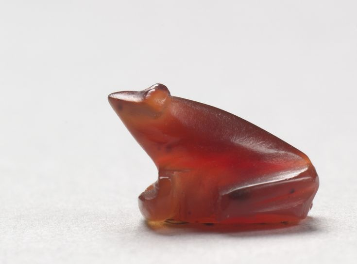 Frog Amulet, c. 1540-1296 BC Egypt, New Kingdom, Dynasty 18 carnelian, Overall - h:0.90 w:0.90 l:1.30 cm (h:5/16 w:5/16 l:1/2 inches). Cleveland Museum of Art