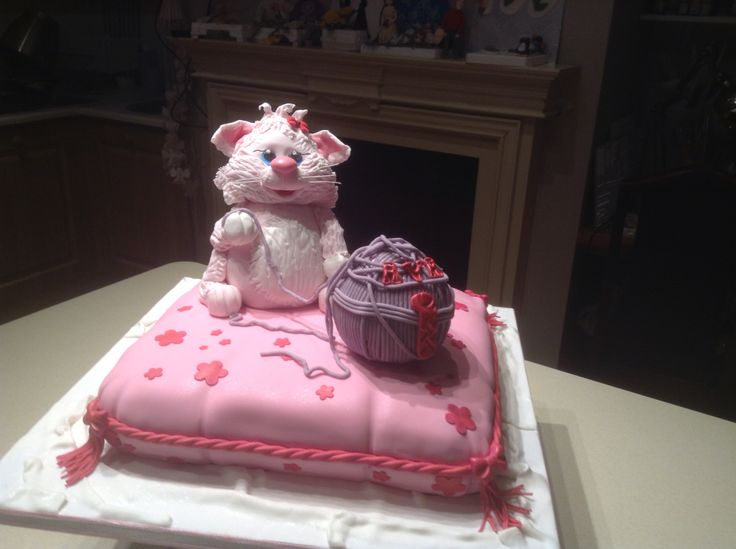 Black magic cake with whipped chocolate filling carved pillow cake with fondant pink cat and ball of wool 4 th birthday cake