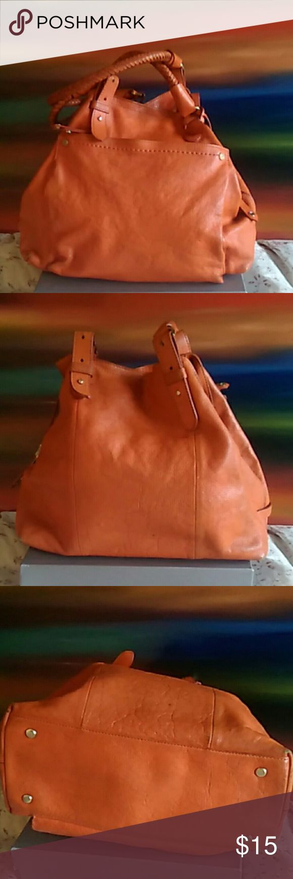 Cole Haan Leather Satchel Orange leather shoulder bag, braided leather handles, handles are adjustable w/ post/ hole . rough heavy leather w/ orange stitching. Handles & bottom corners of bag are are VERY worn! Marks throughout bag. A good cleaning should definitely help. Gold hardware. Zip closure pocket @ front exterior. Tan multi square design interior, zip closure pocket @ back interior & cell phone pockets @ back interior, small ink marks on cell phone pocket interior. Two magnetic top…