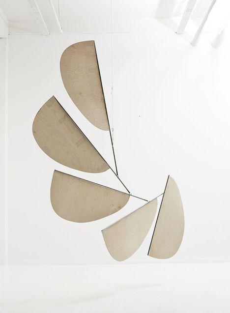 Petal-shaped mobiles balance above GamFratesi's lounge at Stockholm Furniture Fair
