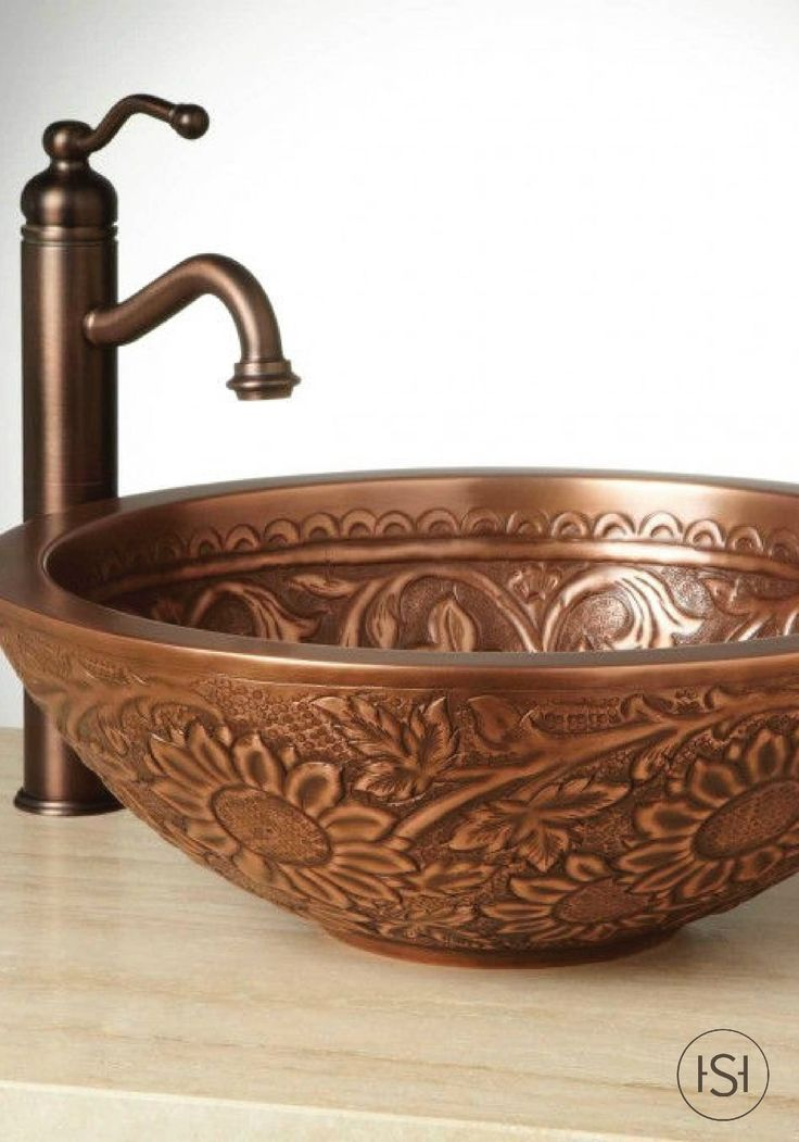 Want to give your dream bathroom more personality in your next remodel? Add a bit of sunshine to your home with the sunflower design of this copper vessel sink from Signature Hardware.