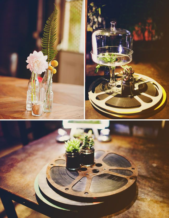 perfect table decorations for movie lovers! this bride and groom even played old romance movies on a big screen during the reception - love it!