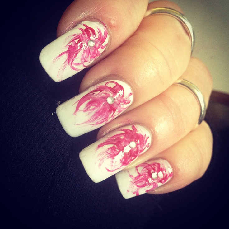 White nails with pink swirls.  3 dots of polish and swirled with a nail art brush.  Added a bit of bling for interest #nailart #bling #longnails #pink