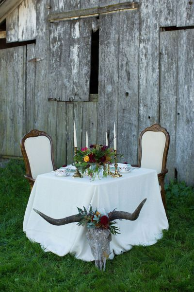 Southwestern inspired sweetheart table: http://www.stylemepretty.com/california-weddings/marin/2015/05/30/bohemian-ranch-wedding-inspiration/ | Photography: Dustin Cantrell - http://www.dustincantrellphotoblog.com/