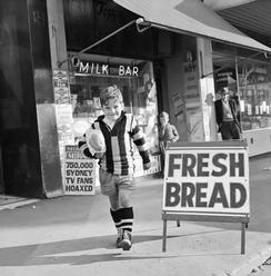 buying bread from a milk bar, Richmond, Victoria 1967.