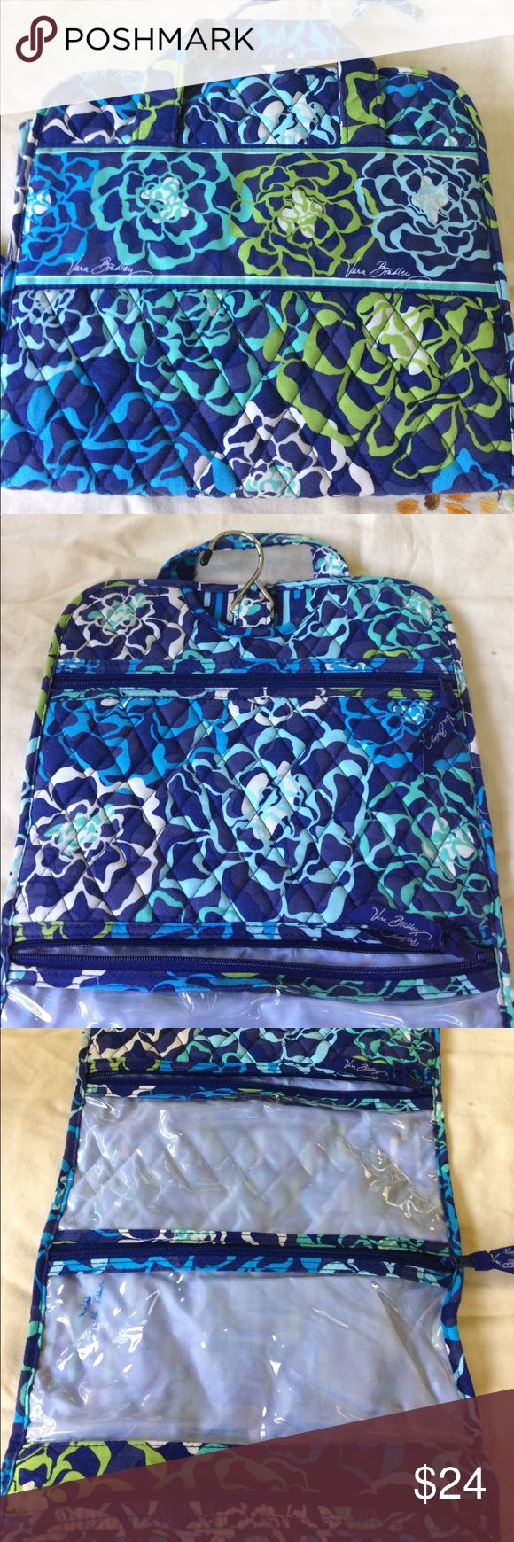 """Vera Bradley """"Catalina Blues"""" Toiletry Bag Four zipping compartment toiletry hanging bag. Display model in store so some minor fading but not noticeable. I used it twice. All zippers working great! Catalina Blues is a retired fabric from fall of 2015 Vera Bradley Bags Cosmetic Bags & Cases"""