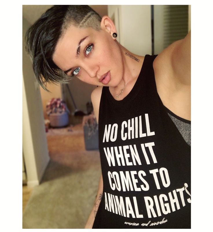 Dark hair undercut. Vegan. Animal rights
