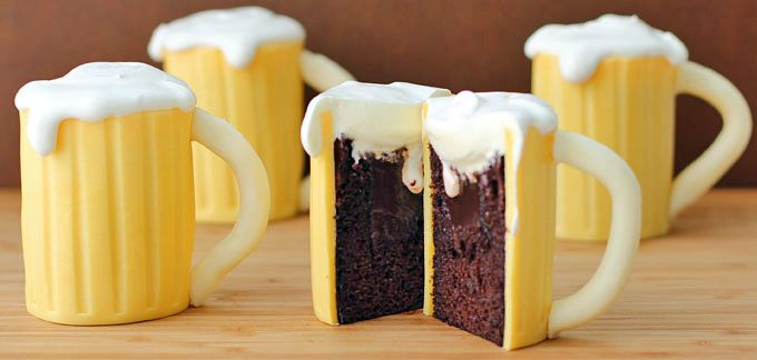 Now this is my kind of beer - a moist chocolate cake filled with luscious Baileys Irish Cream ganache covered in white modeling chocolate and topped off with some whipped cream. Beer Mug Cupcakes with Baileys Filling