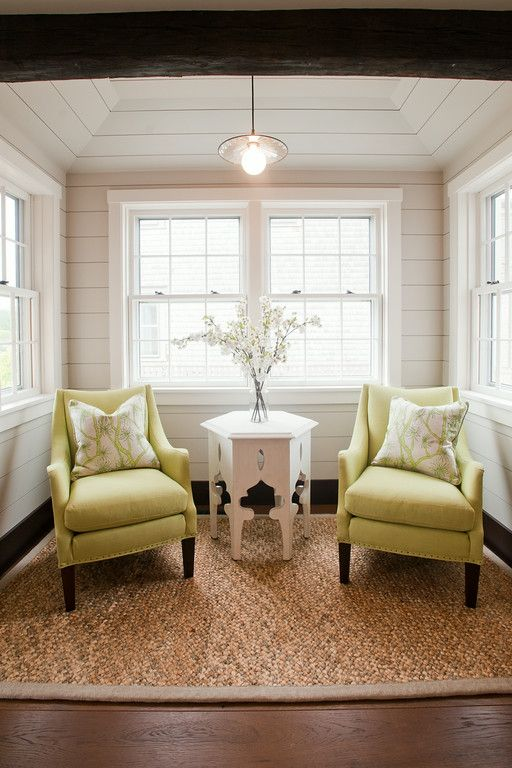 Small sitting area off the kitchen. We used lime green upholstered  armchairs to make this