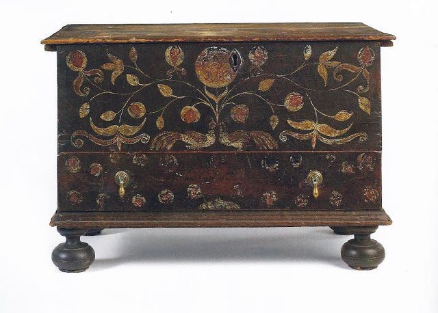 """A William & Mary Diminutive paint-Decorated Pine Chest-With-Drawer, Guilford Area, Coastal Connecticut, Dated 1730. With its original paint decoration and cotter-pin hinges; the central circular reserve with """"AK/ 1730"""". Dimensions: 19 1/4 in high, 29 in. wide, 16 3/8 in. deep. Boldly decorated in red, green & white against a dark ground, this diminutive chest illustrates the penchant for all-over painted furniture along the Connecticut coast during the early decades of the 18th century."""