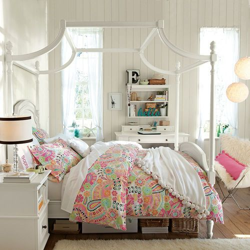 pinchofpixiedust : love the fruity faux-paisley comforter, the white pom-pom coverlet and the bed frame