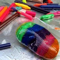 warm rocks in oven for 10 min at 300 degrees. Color with crayons, which will melt onto the rock