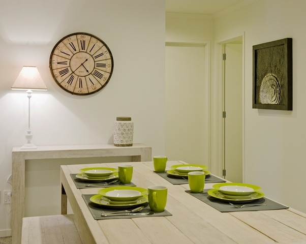 White washed timber dining suite. Casual and fun for this beach retreat.