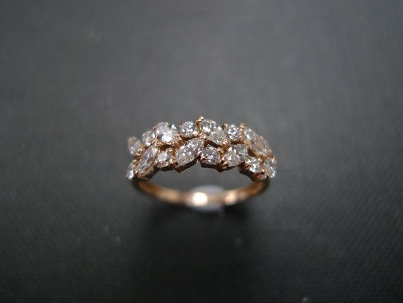 This handmade ring will be a great everyday or elegant simple wedding ring and engagement ring.  Product Specifications: - 8 Round Brilliant Cut Diamonds with 0.24ct - 8 Marquise Shaped Diamonds with 0.48ct Quality: D-F in Color and VS/SI in Clarity, most are VS, and most with Heart and Arrow (Ideal cut) - 14K Rose gold - Ring Width: 2.3mm  The width of the top part of the ring would be around 6.5mm, and the length of all the diamonds cumulated is around 18.5mm.  Currently made to order ...