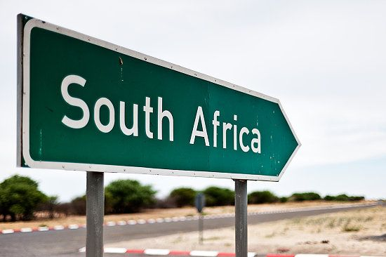 A sign in Botswana pointing out the direction to South Africa. BelAfrique your personal travel planner - www.BelAfrique.com