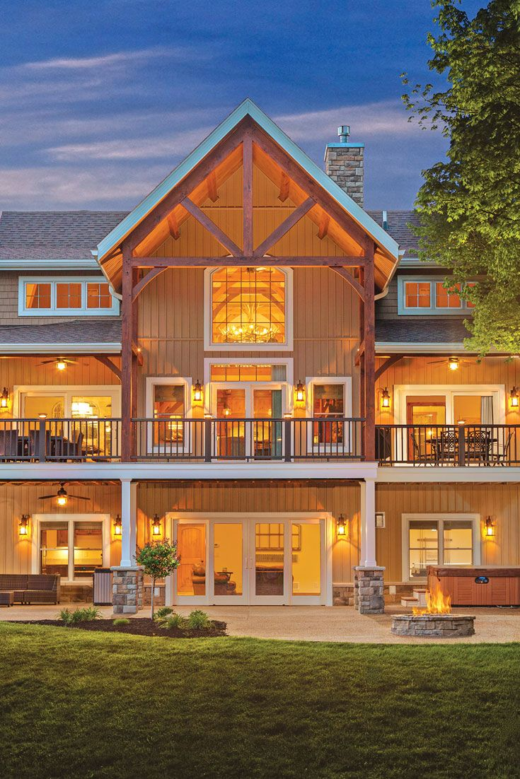 A Warm And Inviting Lakeside Cottage Timber House Waterfront Cottage Timber Frame Homes