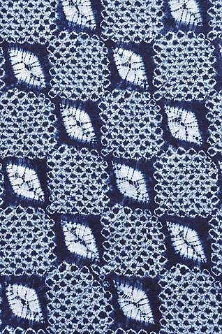 Japanese Shibori Fabric: Diamond. This indigo-dyed shibori cotton fabric is hand-stitched and dyed inJapan.  This type of stitched resist  is achieved by hand-stitching around the patterns with needle and thread, pulling the thread tightly to create a resist for the pattern, and then dipping the cloth into the indigo dye vat multiple times to achieve the deep blue color. | Clothroads