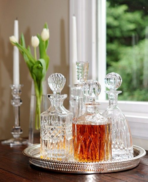 Use those crystal decanters you received for your wedding, put them on a silver tray and set on a rustic farmhouse table for a bit of sparkle!