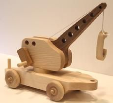 Crane car features a real working crane with a handle that turns and a wooden hook on the end. Picks up the cargo in our Flat Car as well as other small objects that children seem to have in abundance