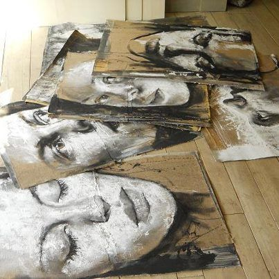 Grayscale paintings on cardboard, I think this unique way of working by the difference in materials. It will give a boldness and unique contrast by the many tines valued against the cardboard.