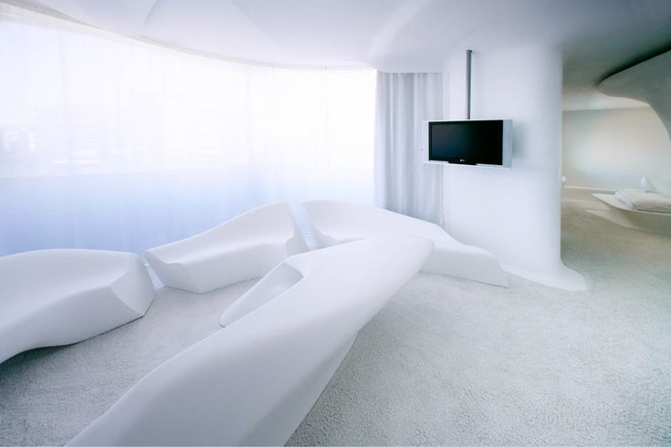 5 Star Hotel Rooms - Silken Puerta América Madrid | Zaha Hadid´s Junior Suites Space Club First-floor is outstanding for its fluidity and the play of bold lines. You will believe you have entered a Sci-Fi but paradoxically accessible world, with everything to hand... [Futuristic Furniture: http://futuristicshop.com/category/futuristic-furniture/]