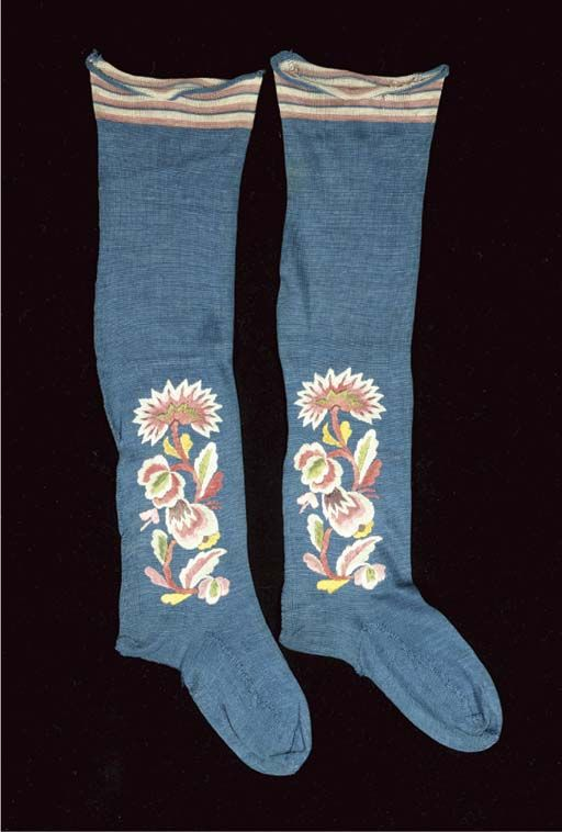 Lady's stockings, 18th century. Blue silk knit embroidered with floral motifs in multicoloured silks.