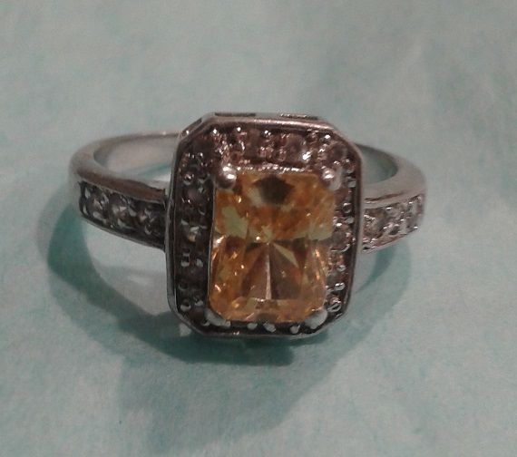 sterling silver ring with canary yellow cubic zirconium