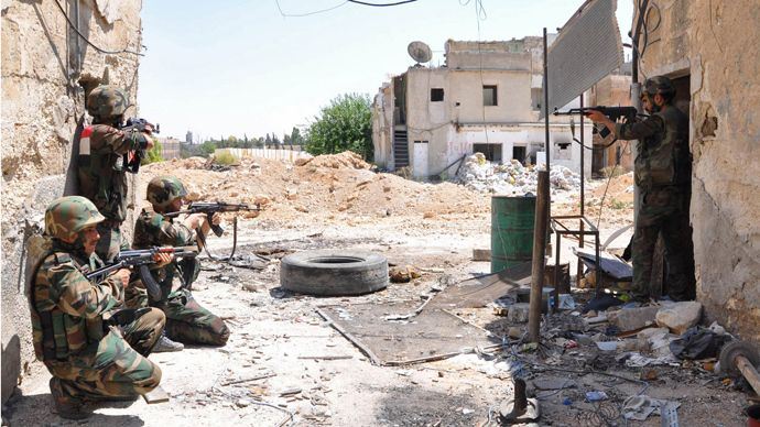 """""""A handout picture released by the Syrian Arab News Agency (SANA) shows a unit of the Syrian armed forces taking position during a patrol near Al-Manashir roundabout in Jobar in the outskirts of Damascus on July 14, 2013 (AFP Photo / SANA)"""""""