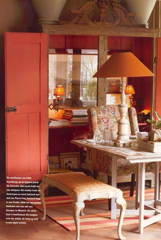 Love how the upper area of the armoire is dressed as a wall and forms the backdrop to the desk.