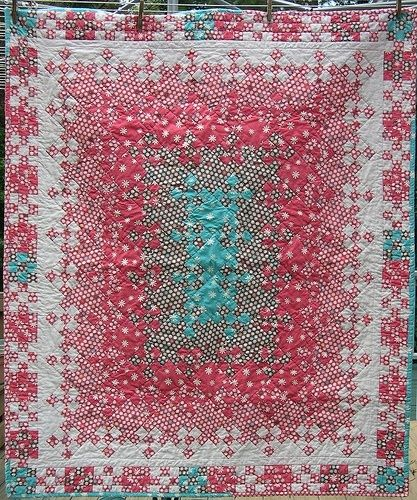 """Blooming nine patch at """"Hip to be a square"""", using extra nine patches as the border by gena"""