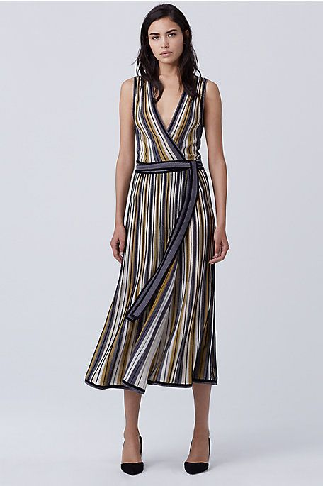 Bold stripes accent this true wrap style in the season's most coveted knit. The fabric features a subtle sheen and the style falls just below the knee.