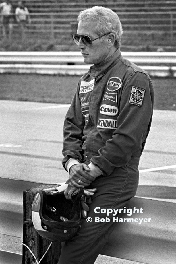 Paul Newman waits to drive the Datsun 280 ZX Turbo that he shared with Sam Posey in an IMSA race at Road America in 1980. we saw him many times