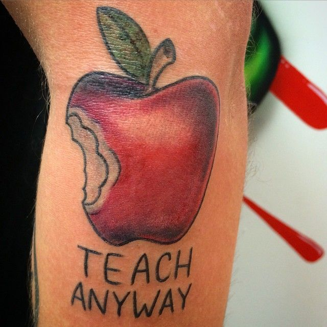 Abel Killian gave his friend the perfect teacher tattoo of a bright, red apple.