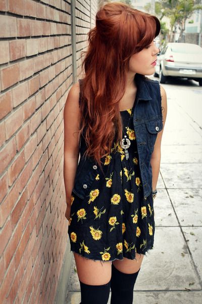 I like the opposites in here: a floral dress with denim vest, blue and orange, thigh highs.  Very cool look : )