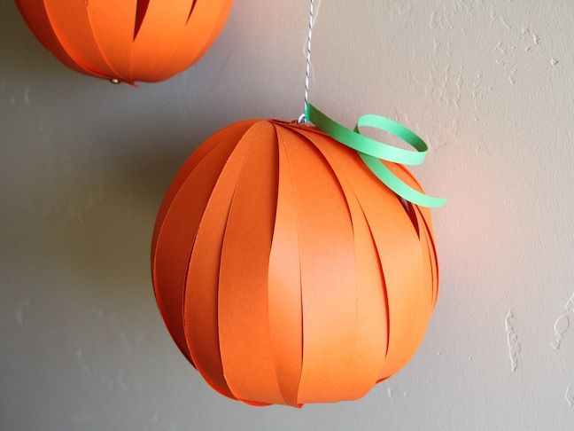 Pumpkin Lantern DIY Craft - doesn't have to be a pumpkin using pastel papers and strung together in a garland