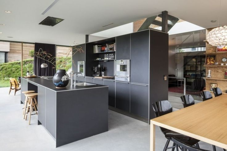 Hotels & Resorts:Attractive Modern Kitchen Design Furniture Ideas With Gray Kitchen Cabinets And Wood Bar Stools And Wood Dining Table Plus Dining Chairs Also With Curtains And Glass Windows With Outdoor View As  Spectacular Modern Villa With an Elegant Wood Interior Design Ideas
