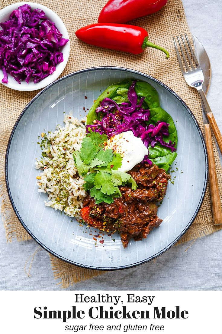 Recipe for A Simple Healthy Chicken Mole by Nourish Everyday - no added sugar, plus it's dairy free and gluten free! The cacao-rich sauce is so full of flavor. The perfect dinner with a side salad and some rice or quinoa.